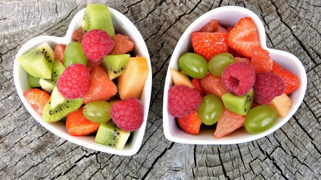 Healthy fruits in heart shaped bowls