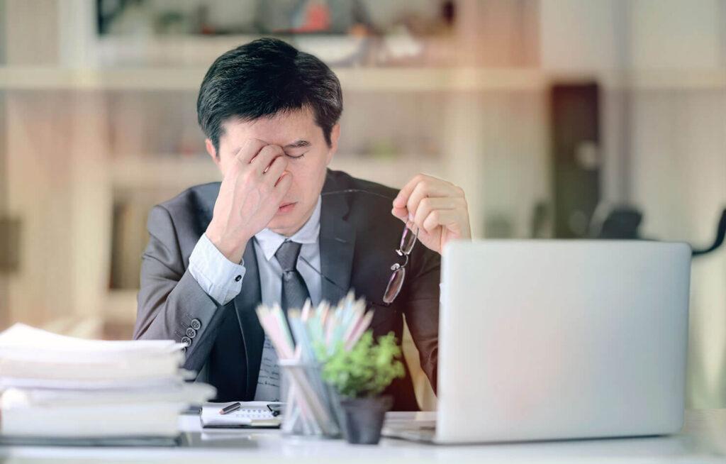 Man stressed sitting at laptop