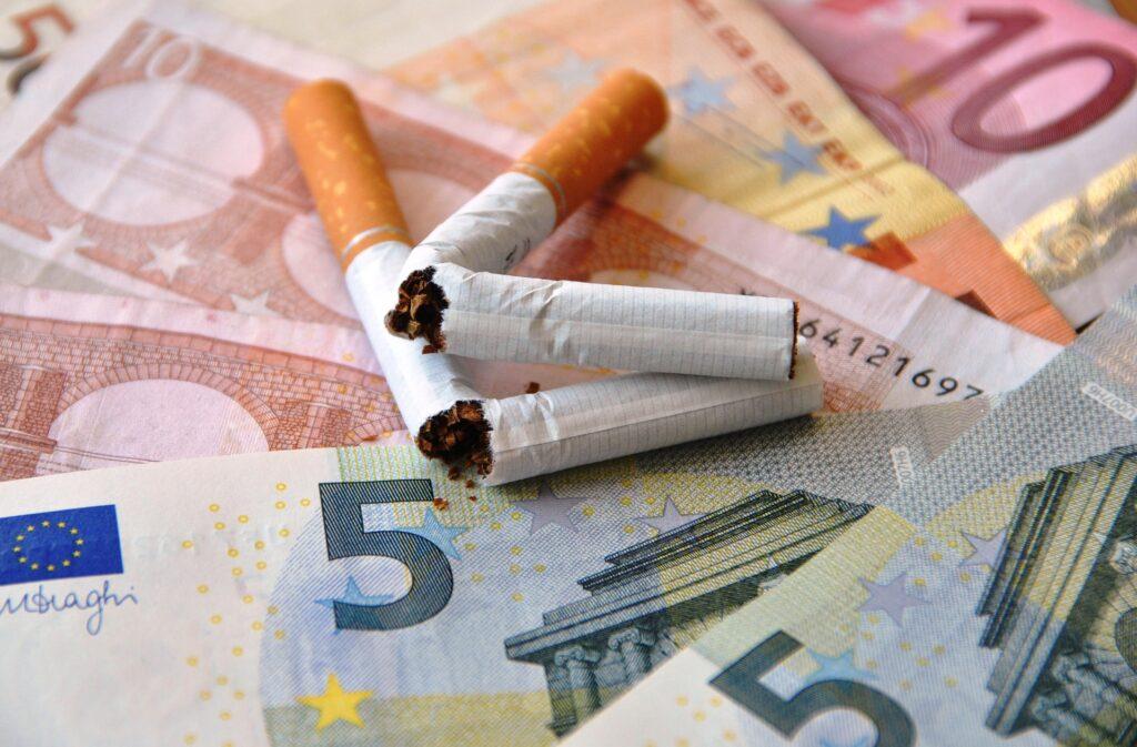 Broken Cigarettes Atop British Pounds